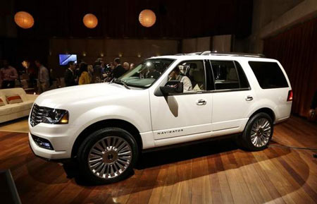 The 2015 Lincoln Navigator, a full-size SUV, is unveiled at the Detroit Auto Show. It will get a mid-cycle makeover and debut in the fall. The Navigator is the luxury brand's most expensive offering. (Carlos Osorio / AP)