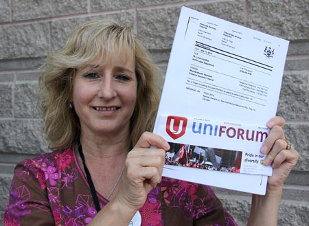 Cathy Wiebenga, former union plant chairperson Navistar workers, displays a copy of the Ontario Financial Services Tribunal ruling ordering Navistar to provide an estimated $28 million for retirees impacted by the closure of the Chatham truck assembly plant. Photo taken Monday, July 14, 2014 in Chatham, ON. ELLWOOD SHREVE/ THE CHATHAM DAILY NEWS/ QMI AGENCY