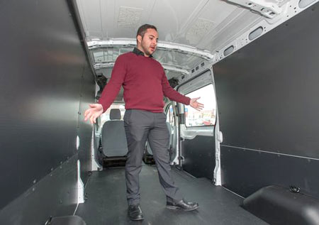 Joe Celentino, sales representative at Village Ford in Dearborn, shows how the roominess inside a Transit van. Ford Motor Co. says sales of the new Transit, which replaced the E-Series, have been brisk, with nearly 5,000 sold in November alone.(Photo: John M. Galloway / Detroit News)