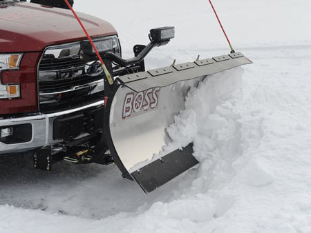 The 2015 Ford F-150 equipped with the Boss Snow Plow made easy work of a snow-covered parking lot
