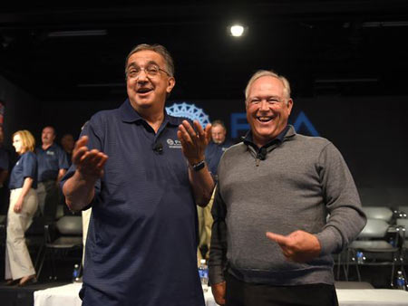 Fiat Chrysler Chairman and CEO Sergio Marchionne, left, and UAW President Dennis Williams - Photo Max Ortiz