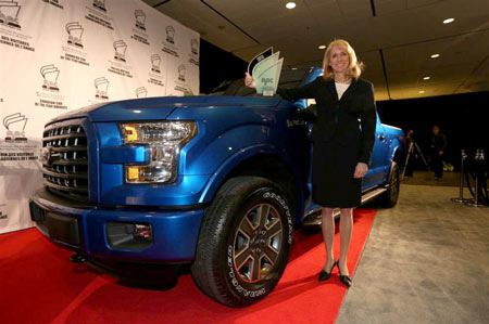 Dianne Craig, president and CEO of Ford Canada, receives the trophy after the Ford F-150 pickup was named the best Utility Vehicle of the year on Feb. 12