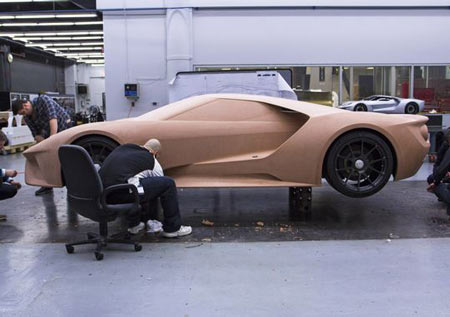Designers work on clay models of Ford's GT Supercar. Ford engineers and designers spent 14 months crafting the 2017 GT Supercar inside a secretive basement room of Ford's Dearborn Product Development Center. (Photo: Ford Motor Company)