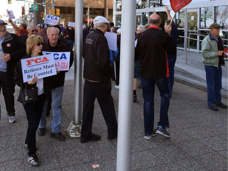Unifor retirees protest in front of FCA Canada headquarters on Riverside Drive. Handout / Windsor Star