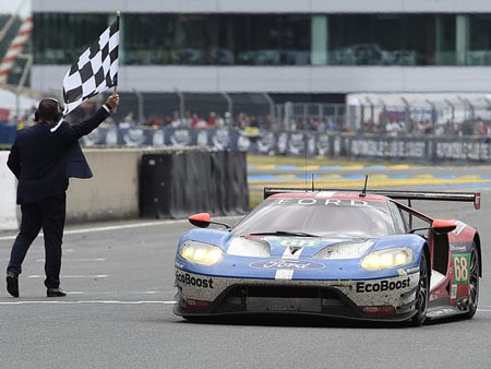Germany's Dirk Mueller crosses the finish line on his Ford GT No. 68, to win the LMGTE PRO category of the 84th Le Mans 24-hours endurance race, on Sunday in Le Mans, western France. Photo Jean-sebastien Evrard / AFP/Getty Images