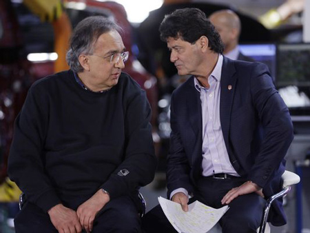 Sergio Marchionne, CEO of Fiat Chrysler Automobiles, left, talks with Unifor President Jerry Dias at the Windsor Assembly Plant, Friday, May 6, 2016 in Windsor, Ontario. Fiat Chrysler and Google announced Tuesday, May 3, that they will work together to more than double the size of Google's self-driving vehicle fleet by adding 100 Chrysler Pacifica minivans.