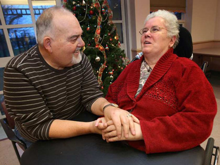 Dec. 8, 2009. Rick Reaume spends time with his wife Sylvia, who has Alzheimer's and has been placed at the Malden Park Continuing Care Centre because she can no longer walk or see. The CAW Local 444 is making a big donation to the Alzheimer's Society on the Reaumes' behalf. (DAN JANISSE/The Windsor Star