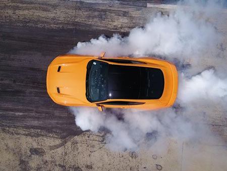 New 2018 Mustang owners won't have to shell out to burn out — a feature that will let drivers burn rubber will come standard in all the refreshed pony cars debuting later this year.