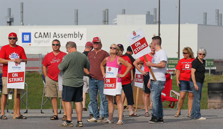 Employees of the GM CAMI assembly factory stand on the picket line in Ingersoll, Ont., on Sept. 18, 2017. THE CANADIAN PRESS/Dave Chidley