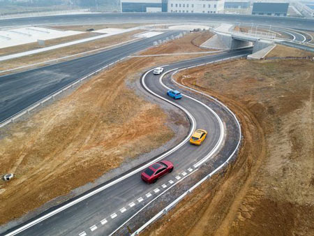 Vehicles drive on the newly-opened Nanjing Test Center, Ford's first vehicle testing facility in China