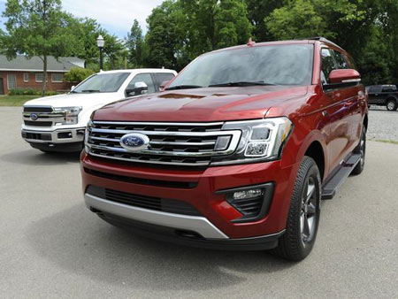 The 2018 Ford Expedition XLT, right, and F-150 King Ranch series are on display for the media at Ford Field Park in Dearborn, Mich. on Thursday, June 15, 2017 (Photo: Jose Juarez / Special to Detroit News)