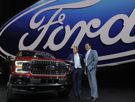 Executive Chairman Bill Ford and President Mark Fields pose next to the new F-150 Monday at the Detroit auto show.