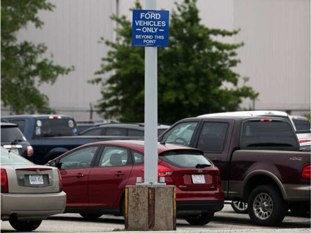 A sign restricting Ford and non-Ford vehicle parking is posted at the automaker's Windsor Engine Plant on Henry Ford Centre Drive in Windsor on June 5, 2017. Jason Kryk / Windsor Star