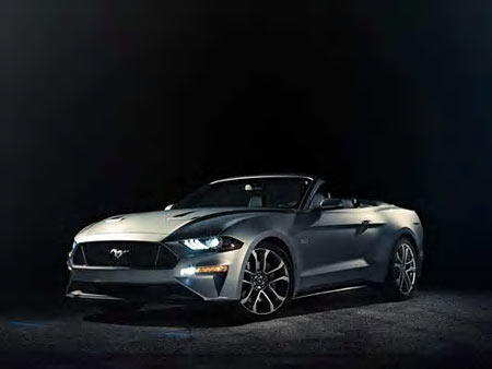 Ford on Friday released photos the first images of its refreshed 2018 Ford Mustang convertible. The topless pony car features the same styling changes and enhancements as its coupe sibling that debuted earlier this week at the Detroit auto show.
