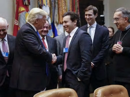 President Donald Trump greets Ford Motor Company CEO Mark Fields, with Fiat Chrysler Automobiles Sergio Marchionne, right, and White House senior adviser Jared Kushner during a meeting with auto industry leaders in the Roosevelt Room of the White House on Jan. 24, 2017