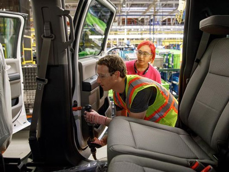 Facebook CEO and founder Mark Zuckerberg helps on the Ford assembly line where an F-150 is being produced.