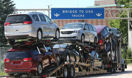 A truck loaded with Chrysler Pacifica models makes its way onto the Ambassador Bridge in Windsor, ON. on Monday, June 11, 2018. (DAN JANISSE/THE WINDSOR STAR)