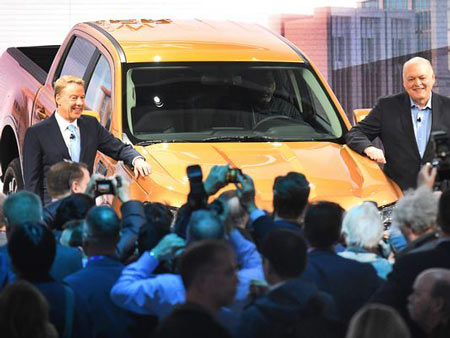 Ford Executive Chairman William Clay Ford Jr. and CEO Jim Hackett pose with the 2019 Ford Ranger truck at the auto show.