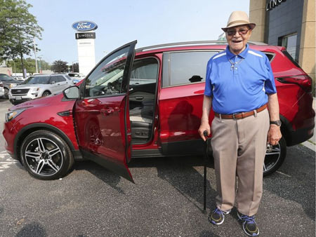 Hitting 100 and ready to hit the road with a fresh set of wheels. Windsor's Earl Wilson, 100, poses next to his new 2019 Ford Escape on July 8, 2019, at the Performance Ford dealership in Windsor. Dan Janisse / Windsor Star
