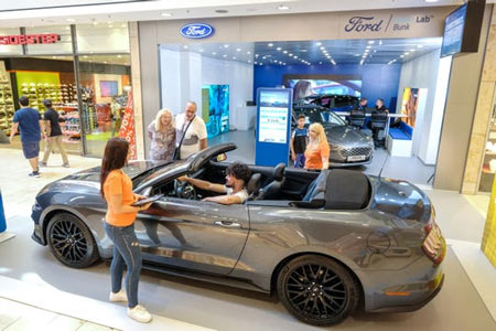 "Ford Motor Co. is testing small ""Smart Lab"" locations in malls outside the U.S. to help dealerships generate sales leads in new ways. This Smart Lab is in Saarbuken, Germany. (Photo: Friedrich Stark, Ford)"