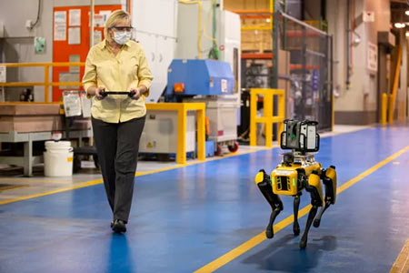 Paula Wiebelhaus navigates Fluffy the robot dog through the Van Dyke Transmission Plant. Ford is leasing two of the robots to map out its factories. (Photo: Ford)