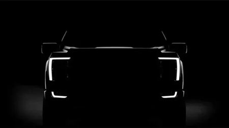 The computer-generated image shows the darkened profile of the new Ford F-150's front end with no features visible except for LEDs framing the grille. (Photo: Ford Motor Co.)