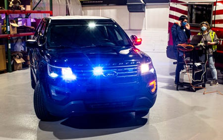Flashing hazard and tail lights of Ford's Police Interceptor Utility vehicle warn officers that the high-temperature interior disinfecting process is running. The sanitation procedure seeks to limit the spread of COVID-19 to first responders. (Photo: Ford)