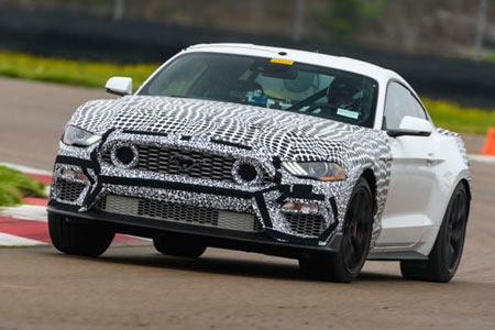 The 2021 Ford Mustang Mach 1, shown testing in camouflage, has signature air intakes in the grille.  (Photo: Wes Duenkel, Ford)