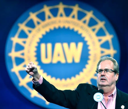 "UAW President Gary Jones fires up delegates Wednesday as he starts the chant, 'We Are One,' during his keynote speech. Jones said automakers are ""on notice"" over the closing of plants and shipping jobs to Mexico. (Photo: Todd McInturf, The Detroit News)"