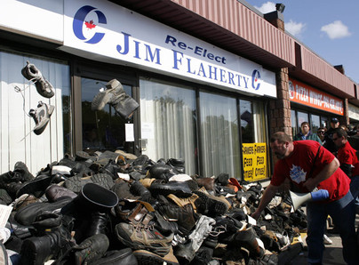 Hundreds of Canadian Auto Worker Union members gathered to present Finance Minister Jim Flaherty with thousands of old work boots collected from laid off workers from across Ontario. The CAW left the boots at Flaherty's Whitby-Oshawa riding office Oct. 6.