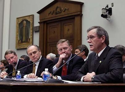 Auto executives listen as United Autoworkers Union President Ron Gettelfinger, right, testifies on Capitol Hill in Washington on Nov.19, 2008, before the House Financial Services Committee. From left are, GM chief executive Richard Wagoner; Chrysler CEO Robert Nardelli and Ford chief executive Alan Mulally.