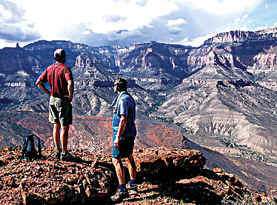 Hikers admire the view from Nankoweap Butte in the Grand Canyon National Park. Comparatively few visitors venture down to the bottom of the canyon, where other experiences await.