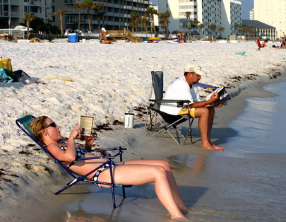Sunseekers relax on a beach in Destin, Fla. The Sunshine State offers of housing options to fit a range of incomes.