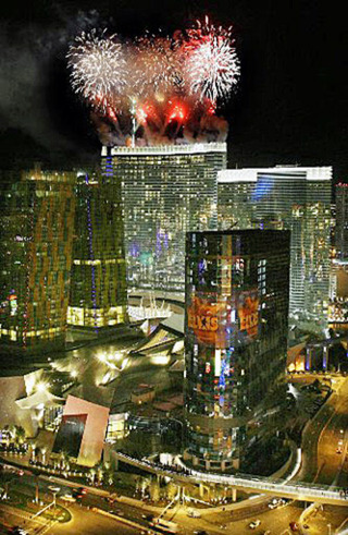 Fireworks shoot off the Aria Hotel and Casino moments before its opening at CityCenter in Las Vegas on Wednesday Dec 16, 2009