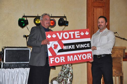 Next step for Mike is the Mayor's office (Holding sign with his son)