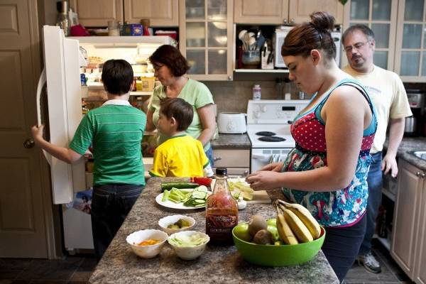 Kim and Warren Horricks of Calgary prepare dinner with Nate, 7, Aaron, 12 and Amanda, 14, who recently found out that along with running a risk of diabetes, she has high blood pressure. Her mother has tried to cut the fat and sugar in the family diet, but hasn't made a dent in their sodium intake.